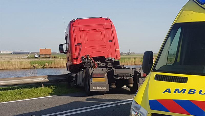 Ongeval auto en truck Burgerbrug