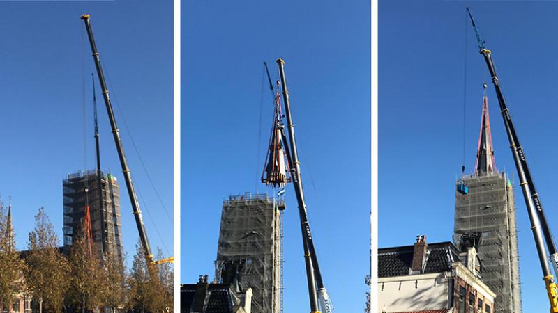 Gelukt! De torenspits van de Laurentiuskerk staat weer op z'n plek