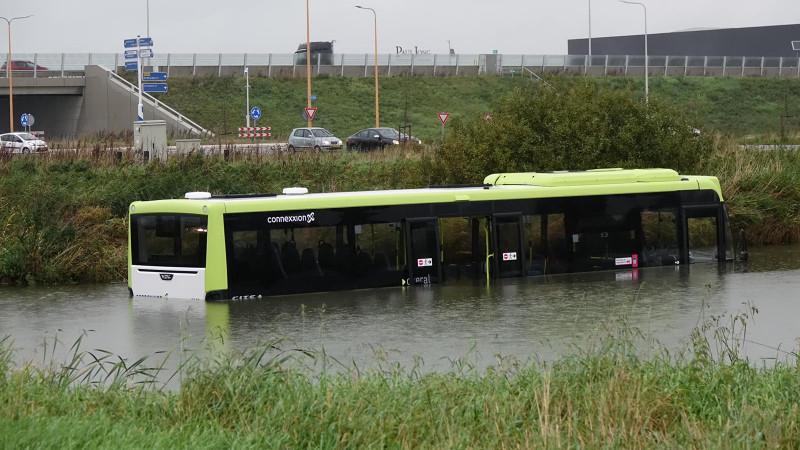Bus in water Zwaag